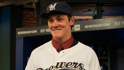 Clint Coulter, the Brewers' top pick last month, recorded three hits Saturday.